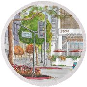 Wilshire Blvd. And Camden Dr. In Beverly Hills, California Round Beach Towel