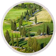 Winding Cypress Lined Road Of Monticchiello Round Beach Towel by IPics Photography