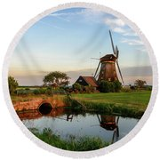 Round Beach Towel featuring the photograph Windmill In The Countryside In Holland by IPics Photography