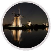 Windmills Illuminated At Night Round Beach Towel
