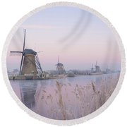 Windmills In The Netherlands In The Soft Sunrise Light In Winter Round Beach Towel