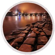 Winter Night Near Charles Bridge In Prague, Czech Republic Round Beach Towel