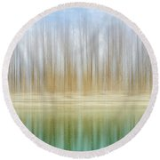 Winter Trees On A River Bank Reflecting Into Water Round Beach Towel