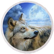 Round Beach Towel featuring the mixed media Wolf Glow by Carol Cavalaris