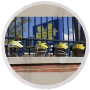 Wolverine Helmets Of Different Eras On Stadium Wall Round Beach Towel
