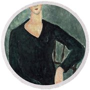Woman In A Blue Dress Seated Round Beach Towel