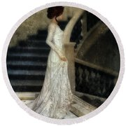Woman In Lace Gown On Staircase Round Beach Towel by Jill Battaglia