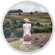 Woman On A Hill Round Beach Towel