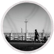 Round Beach Towel featuring the photograph Woman Walking In Industry by John Williams