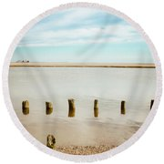 Round Beach Towel featuring the photograph Wood Pilings In Shallow Waters by Colleen Kammerer