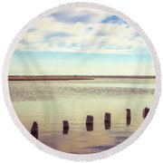 Round Beach Towel featuring the photograph Wood Pilings In Still Water by Colleen Kammerer