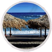 Wood Thatch Umbrellas On Black Sand Beach, Perissa Beach, In Santorini, Greece Round Beach Towel