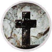 Wrought Iron Cross Against Stone Round Beach Towel