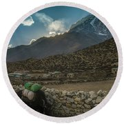 Round Beach Towel featuring the photograph Yaks Moving Through Dingboche by Mike Reid