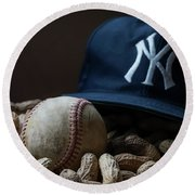 Round Beach Towel featuring the photograph Yankee Cap Baseball And Peanuts by Terry DeLuco