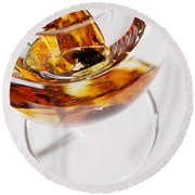 Round Beach Towel featuring the photograph Yellow Amber Stones In A Glass. by Andrey  Godyaykin