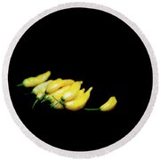 Yellow Chillies On A Black Background Round Beach Towel