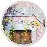 Round Beach Towel featuring the photograph Yellow Flowers And Decayed Wall by Silvia Ganora