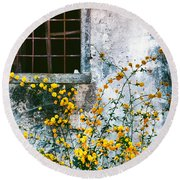 Round Beach Towel featuring the photograph Yellow Flowers And Window by Silvia Ganora