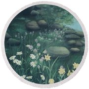 Yellow Flowers In Bed Of Rocks Round Beach Towel