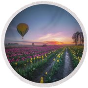 Round Beach Towel featuring the photograph Yellow Hot Air Balloon Over Tulip Field In The Morning Tranquili by William Lee