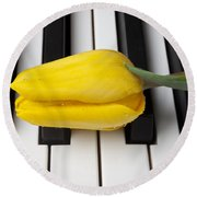 Yellow Tulip On Piano Keys Round Beach Towel