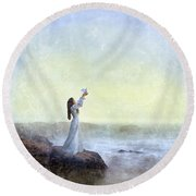 Young Lady Releasing A Dove By The Sea Round Beach Towel