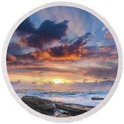 An Atmospheric Sunrise Seascape Round Beach Towel