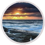 A Moody Sunrise Seascape Round Beach Towel