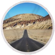 Round Beach Towel featuring the photograph Lonely Road In Death Valley National Park In California by Alex Grichenko