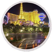 Round Beach Towel featuring the photograph Nigh Life And City Skyline In Las Vegas Nevada by Alex Grichenko