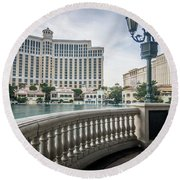 Round Beach Towel featuring the photograph Bellagio Hotel And Other Architecture In Las Vegas Nevada by Alex Grichenko