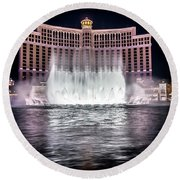Round Beach Towel featuring the photograph World Famous Fountain Water Show In Las Vegas Nevada by Alex Grichenko