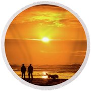 A Couple Walking Their Dog At Sunset On Ynyslas Beach, Wales Uk Round Beach Towel