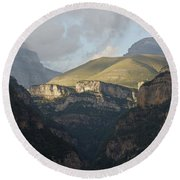 Round Beach Towel featuring the photograph A Dash Of Light In The Canyon Anisclo by Stephen Taylor
