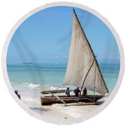 Round Beach Towel featuring the photograph A Dhow In Zanzibar by Kay Brewer