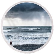 A Woman In The Sea On A Stormy Day  Round Beach Towel