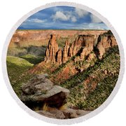 After The Storm Light On Colorado National Monument Round Beach Towel