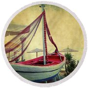 an Old Boat Round Beach Towel