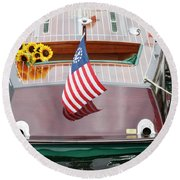 Round Beach Towel featuring the photograph Antique Wooden Boat With Flag And Flowers 1304 by Rick Veldman