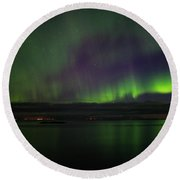 Aurora Borealis Reflecting At The Sea Surface Round Beach Towel