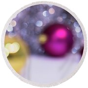 Round Beach Towel featuring the photograph Blurry Christmas Background With Christmas Balls And Bokeh by Cristina Stefan