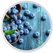 Bowl Of Fresh Blueberries On Blue Rustic Wooden Table From Above Round Beach Towel