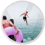 Boys Jumping Into The Sea Round Beach Towel