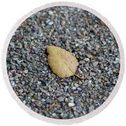 Round Beach Towel featuring the photograph Brown Leaf On Gravel by Scott Lyons