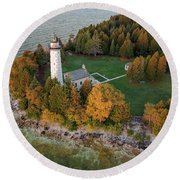 Round Beach Towel featuring the photograph Cana Island Lighthouse At Dawn by Adam Romanowicz