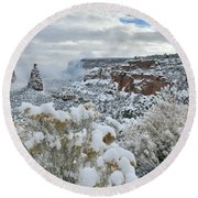 Clouds Break Over Snow Covered Independence Canyon Round Beach Towel
