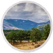 Clouds Over The Rockies Round Beach Towel