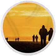 Couples Walking Along The Beach At Sunset Round Beach Towel