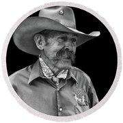 Round Beach Towel featuring the photograph Cowboy by Jim Mathis